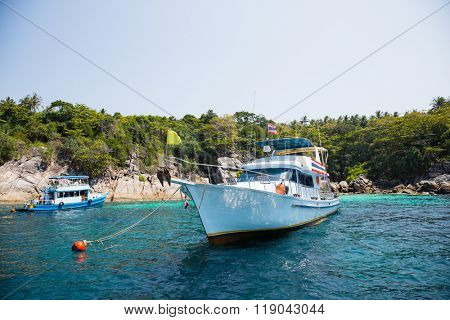Cruise boats with tourists off the island in the Andaman Sea, coast Thailand