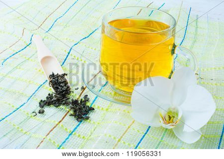 Cup Of Green Tea On Green Napkin