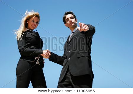 Young successful businessman and businesswoman as team