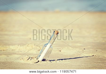 Retro Toned Message In A Bottle On Beach, Shallow Depth Of Field
