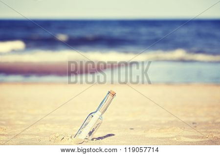 Vintage Toned Message In A Bottle On Beach, Shallow Depth Of Field