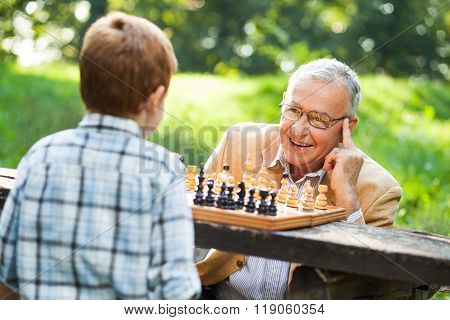 Grandfather and grandson in park