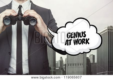 Genius at work text on speech bubble with businessman holding binoculars