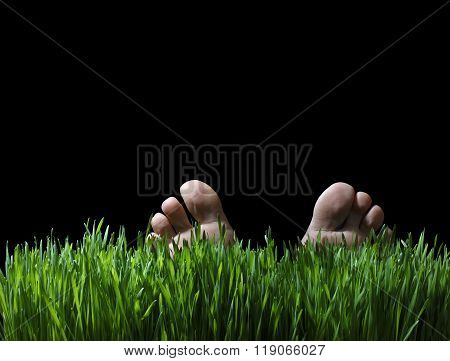 Feet Of A Person Laying In Green Grass At Night