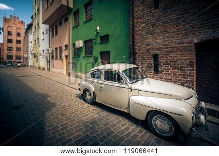 Retro Car In Street Of Gdansk, Poland, Europe.