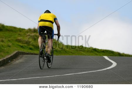 Cyclist Riding Uphill