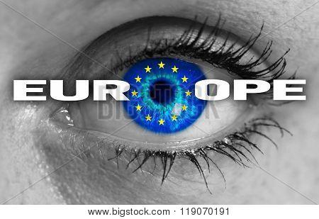 Europe Eye Looks Through Flag Concept