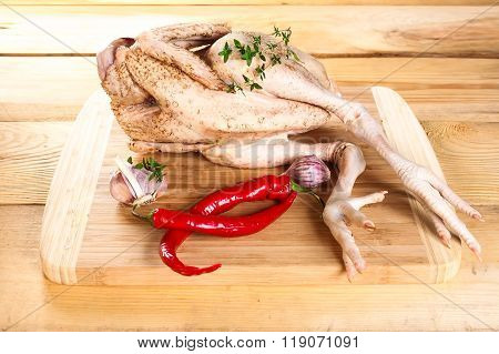 Fresh raw chicken carcass wooden board with pepper