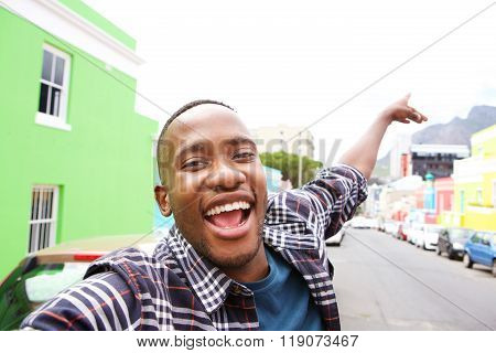 Excited Young African Guy Taking A Selfie