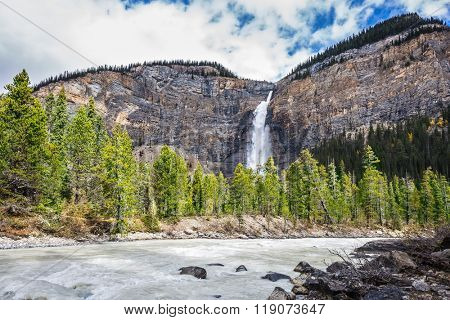 Autumn day in Yoho National Park in the Rocky Mountains of Canada. Colossal Takakkaw waterfall formed by melting glacier Daly