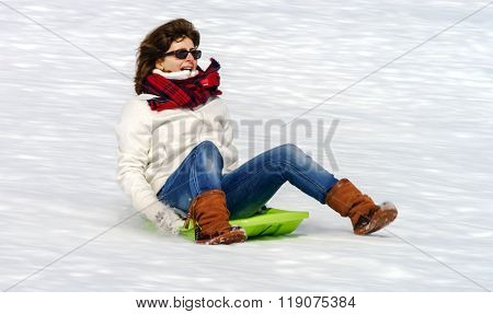 Woman Running On Sleds From  The Hill