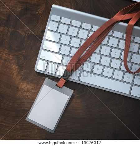 Blank badge with red tape on the keyboard. 3d rendering