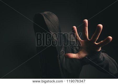Spooky Hooded Person Without Face In Dark Room