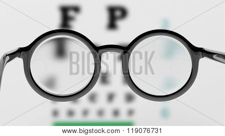 Pair of round-lens eyeglasses with eyesight test and blur