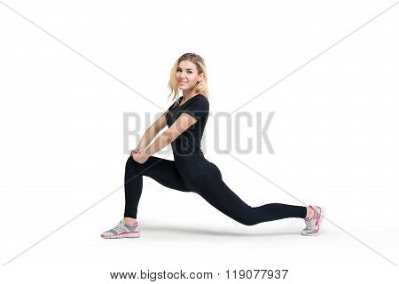 Woman Doing Fitness Forward Lunge Isolated At White