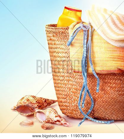 Closeup photo of beautiful beach items on seashore, stylish accessories for rest on tropical resort, summer vacation concept