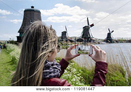Woman Photographer Windmills At Zaanse Schans, Amsterdam, Holland