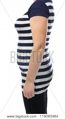 Chubby woman's body in striped tee-shirt and black pants isolated on white
