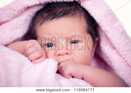 Newborn Baby  Girl On A Soft Pink Terry Towel