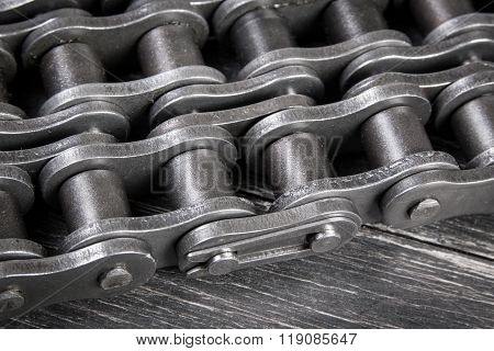 industrial roller chain on dark background