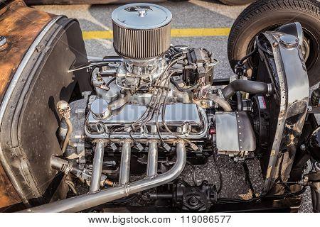 side closeup view of retro classic vintage hot rod  car engine