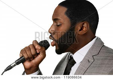 Darkskinned man sings jazz.