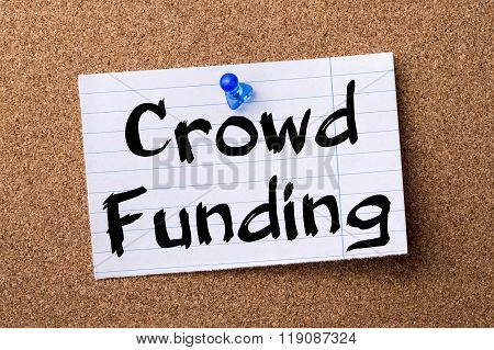 Crowd Funding - Teared Note Paper Pinned On Bulletin Board