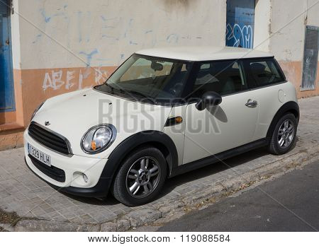 VALENCIA, SPAIN - FEBRUARY 22, 2016: A Mini Cooper car parked in the street in Valencia, Spain. In 1999 the Mini was voted the second most influential car of the 20th century, behind the Ford Model T.