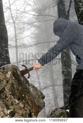 Knight Removes The Magical Excalibur Sword In The Stone