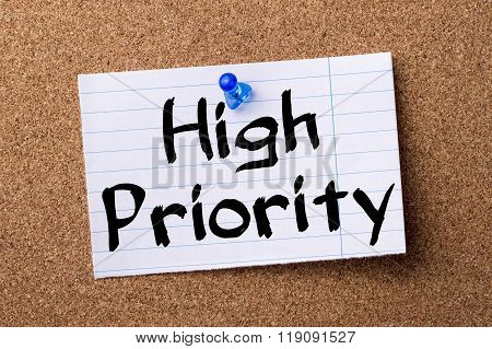 High Priority - Teared Note Paper Pinned On Bulletin Board