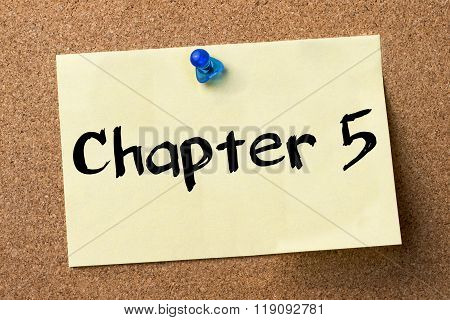 Chapter 5 - Adhesive Label Pinned On Bulletin Board