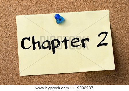 Chapter 2 - Adhesive Label Pinned On Bulletin Board