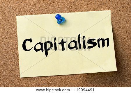 Capitalism - Adhesive Label Pinned On Bulletin Board