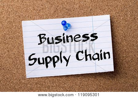 Business Supply Chain - Teared Note Paper Pinned On Bulletin Board