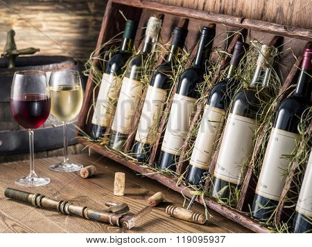 Wine bottles on the wooden shelf.