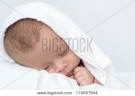 baby sleep under a white blanke