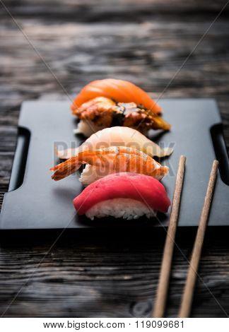 sashimi sushi set with chopsticks and soy