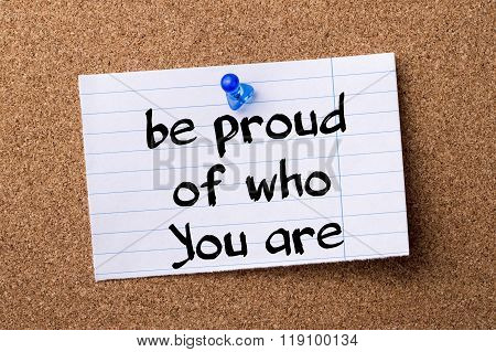 Be Proud Of Who You Are - Teared Note Paper Pinned On Bulletin Board