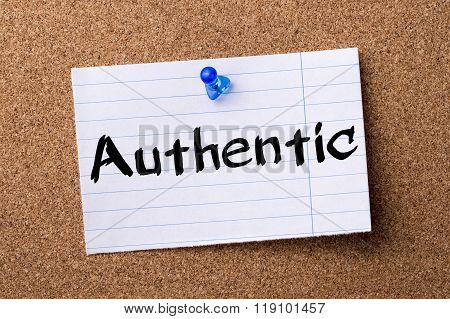 Authentic - Teared Note Paper Pinned On Bulletin Board
