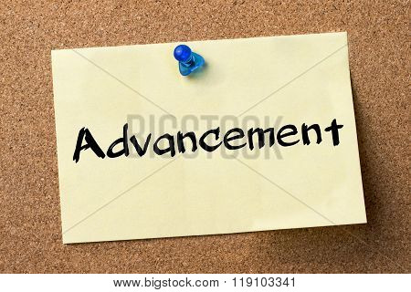 Advancement - Adhesive Label Pinned On Bulletin Board