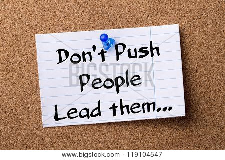 Don't Push People Lead Them… - Teared Note Paper Pinned On Bulletin Board