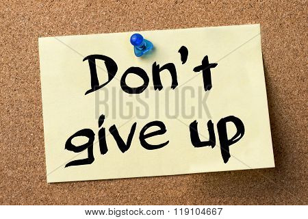 Don't Give Up - Adhesive Label Pinned On Bulletin Board