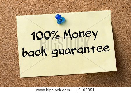 100% Money Back Guarantee - Adhesive Label Pinned On Bulletin Board