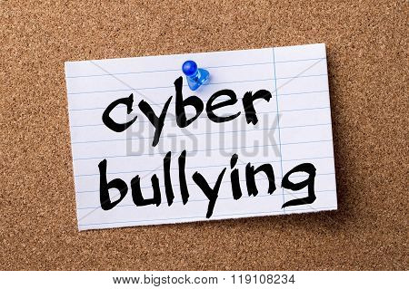Cyber Bullying - Teared Note Paper Pinned On Bulletin Board