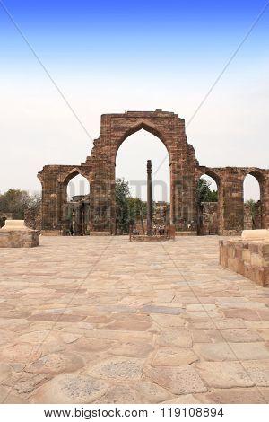 Iron Pillar and Qutab Minar Ruins in Delhi, India. UNESCO world heritage site