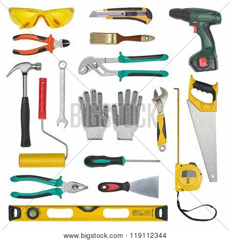 Set of construction tools isolated on a white background. Level, saw, glasses, tape measure, wrench,