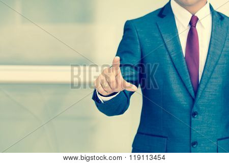 Businessman Pushing On A Touch Screen. Vintage Color Tone
