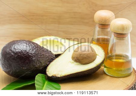 Avocado Oil On Wood Background
