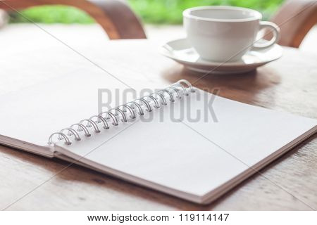 Open Blank White Notebook With Cup Of Coffee