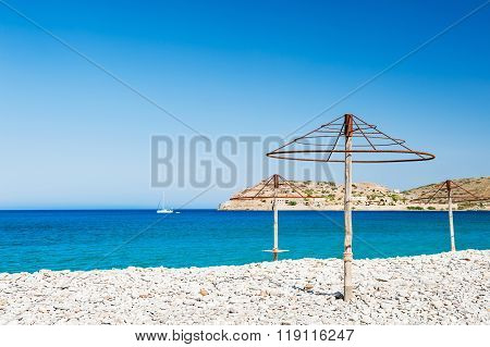 Empty Beach With Turquoise Water And White Pebbles
